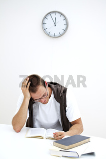 student reading under a clock