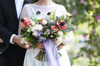 Wedding ceremony. Groom and bride with bouquet