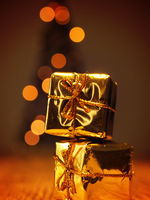 Two golden Christmas gift boxes