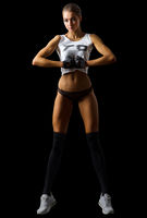 Young fitness girl isolated on black