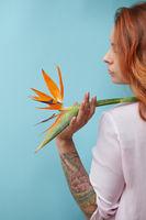 Girl holding an strelitzia flower