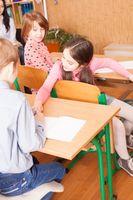 School girl explaining her classmate