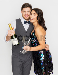 happy couple with champagne and glasses at party