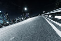 nigh scene of empty road in modern city
