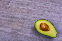 Cut avocado on a wooden table