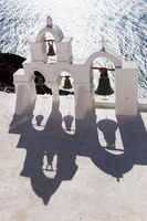 Traditional bell tower in Oia village of Cyclades Island, Santorini, Greece.