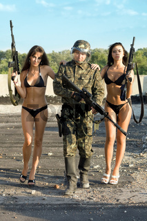 Two women with soldier