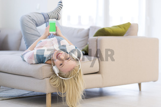 girl enjoying music through headphones