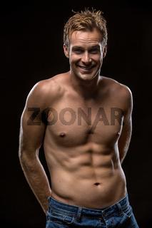 Guy with nude torso in studio