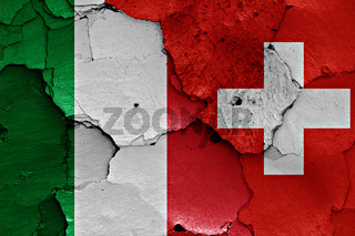 flags of Italy and Switzerland painted on cracked wall