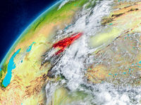 Space view of Kyrgyzstan in red