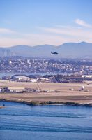 Summer in the San Diego. San Diego Skyline and Military Choppers on the Sky over the bay