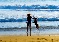 Woman with dog at beach