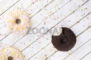 Chocolate Donut on a wooden white background