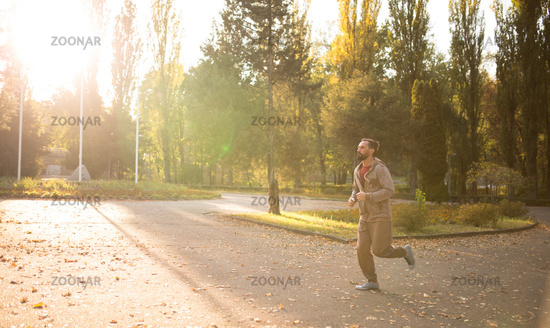 Man running in morning sunshine.