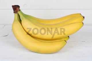 Bananen Frucht Früchte auf Holzplatte