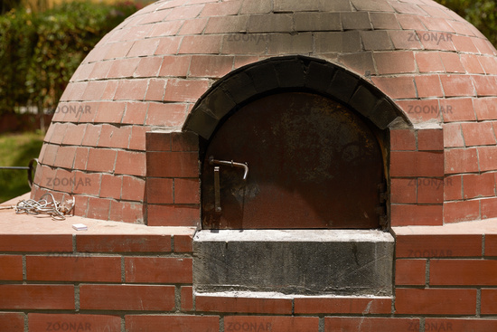 Close Up of Small Rural  DIY Brick Smokehouse Ready for BBQ