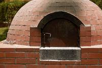 Close Up of Small Rural  DIY Brick Smokehouse Ready for BBQ