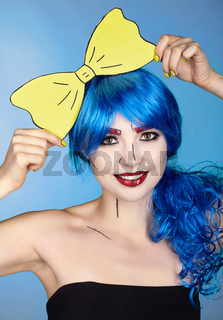 Portrait of young woman in comic  pop art make-up style. Girl with yellow bow-tie in hands