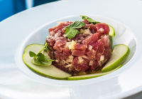 A plate of delicious tuna tartare with green apple