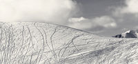 Panoramic view on slope for freeriding with traces from skis, snowboards