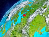 Space view of Estonia in red