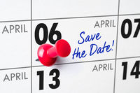 Wall calendar with a red pin - April 06