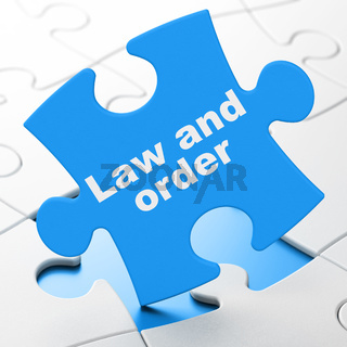 Law concept: Law And Order on puzzle background