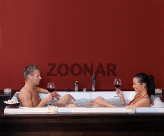 Happy couple in jacuzzi