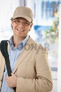 Young businessman leaving office