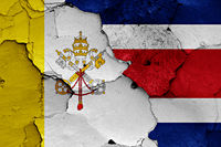 flag of Vatican and Costa Rica painted on cracked wall