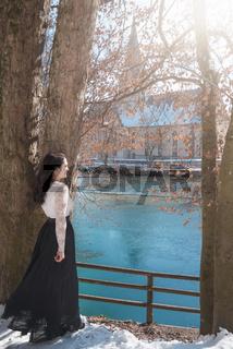 Elegant young woman on lakeshore
