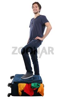 Junger Mann Koffer packen Reise reisen verreisen Urlaub jung Freisteller