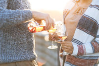 Man and woman with wineglasses outdoors