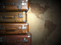 Vintage suitcases on the map of America background.Turism travel concept.