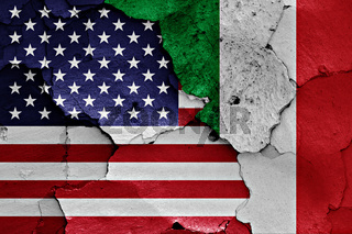 flags of USA and Italy painted on cracked wall