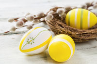 Yellow easter eggs on a wooden background