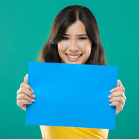 Holding a blue paper