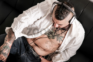 Tattooed man on the sofa