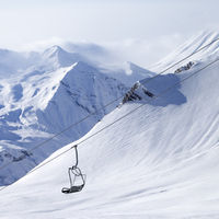 Chair lifts and off-piste slope in haze