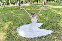 Beautiful bride in white lace dress of summer time