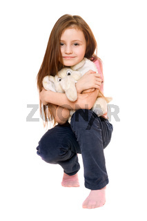 Beautiful little girl with a teddy elephant. Isolated