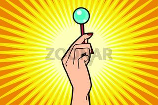 Lollipop in female hand
