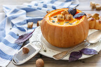 Pumpkin soup with spices and croutons in the pumpkin.