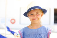 Cute caucasian girl in hat on the beach