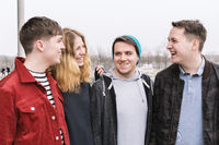 group of young friends having fun and laughing together
