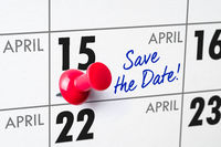 Wall calendar with a red pin - April 15