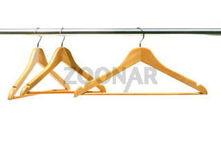 Three coathangers on a clothes rail