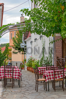 Restaurant tables on street terrace