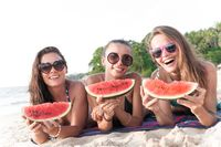 Female friends eating watermelon
